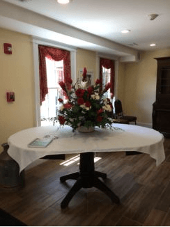 Welcoming Entrance and Large Table with Flower Arrangement
